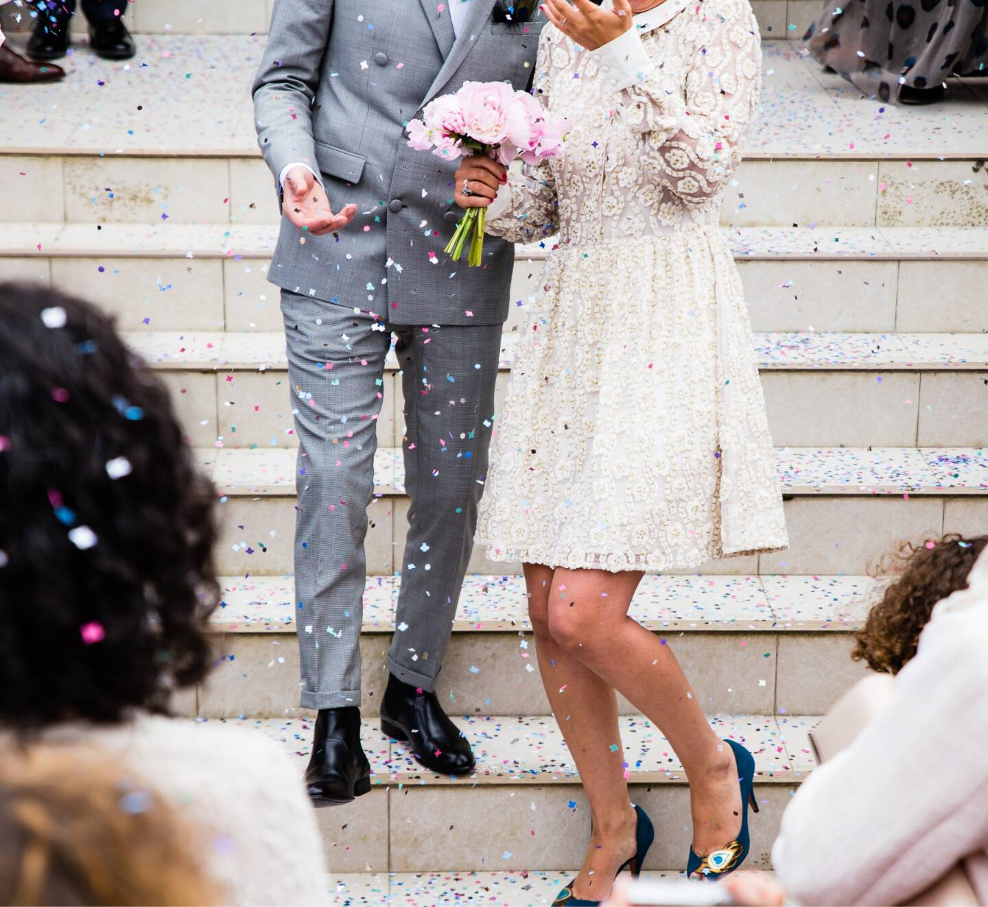 married couple descending steps of a London wedding venue