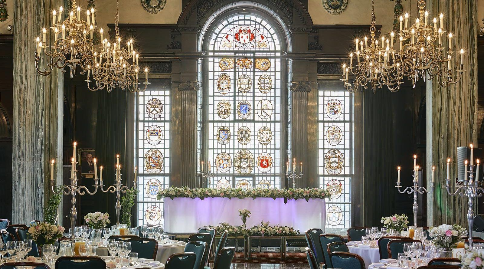 Wedding venue with candlearbre and stained glass window