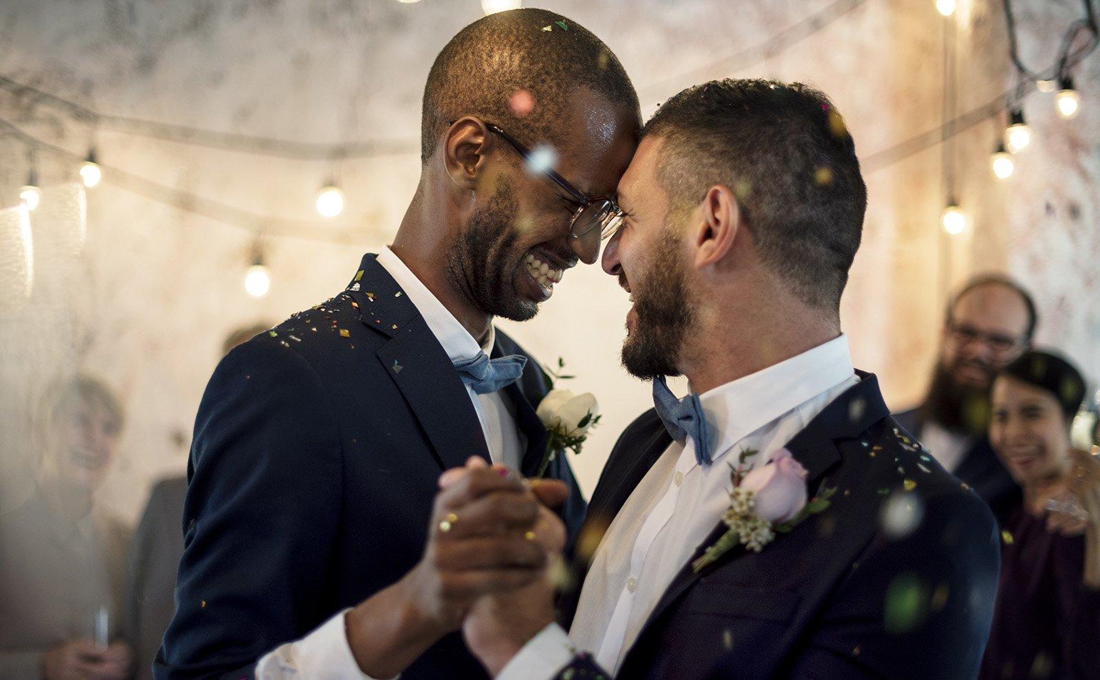 Husbands dancing together at their wedding