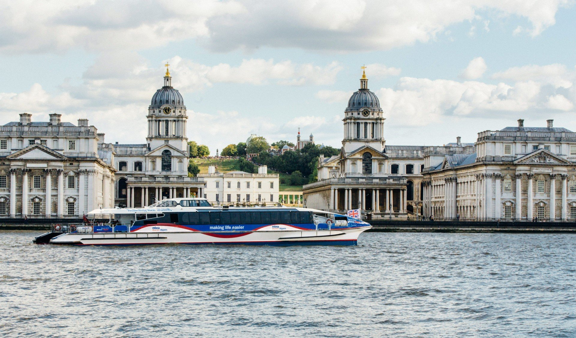 Arriving at old royal naval college by boat as a quirky christmas party idea